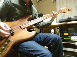 Playing base guitar